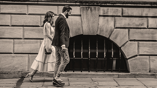 Professional couple walking along the city streets