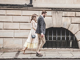 Professional couple walking in city street